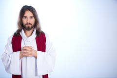 Jesus Christ full of peace. Praying, isolated on bright background stock image