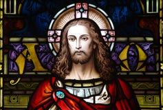 Jesus Christ in gebrandschilderd glas (het begin en het eind) Stock Afbeeldingen