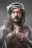 Jesus Christ with a halo of white light over grey background Royalty Free Stock Image