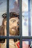 Jesus Christ head statue behind bars Stock Photography