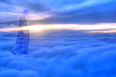 Jesus Christ in Heaven religion concept. Jesus Christ in blue sky with clouds heaven stock photo