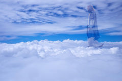 Jesus Christ in Heaven religion concept. Jesus Christ in sky with clouds heaven royalty free stock images