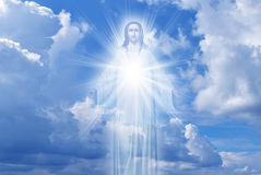 Jesus Christ in Heaven religion concept. Jesus Christ in sky with clouds heaven Stock Image
