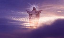 Jesus Christ in Heaven religion concept. Jesus Christ statue against beautiful sky background Royalty Free Stock Photos