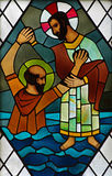 Jesus Christ helping a drowning man. Stained glass window Jesus helping a drowning man Stock Photo