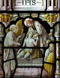 Jesus Christ helping a poor man (in stained glass). A photo of Jesus Christ helping a poor man (in stained glass stock image