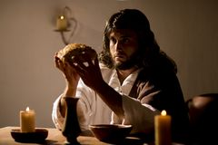 Jesus Christ holding the prayer. Jesus christ holding prayer to god father at his last supper stock photos