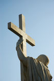 Jesus Christ holds passion cross Royalty Free Stock Photography