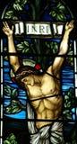 Jesus Christ korsfäste i målat glass Royaltyfri Bild