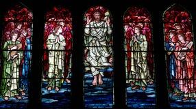 Jesus Christ levé en verre souillé Photographie stock