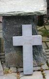 Jesus Christ Lives Cross. Slate Cross found propped against a seat at a slate mine deep in the Beautiful Lake District of England Stock Image