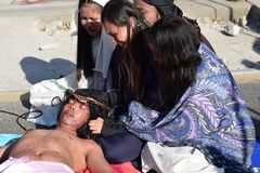 Jesus Christ lying on crying women`s lap street drama, community celebrates Good Friday representing the events that led to the hi. San Pablo City, Laguna royalty free stock photo