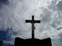 Jesus Christ. Majority of people in Reunion island is Catholic. The cross is always seen near the church stock images