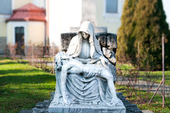 Jesus Christ and Mary. Public sculpture in churchyard Royalty Free Stock Photography