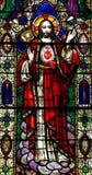 Jesus Christ med den sakrala hjärtan i målat glass Royaltyfri Foto