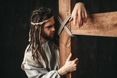 Jesus Christ med korsfästelse på svart bakgrund Royaltyfri Bild