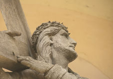 Jesus Christ from Musninkai belfry, Lithuania. Crist with cross close up Stock Photos