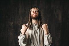Jesus Christ na veste branca reza emocionalmente imagem de stock royalty free