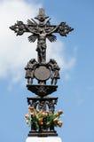 Jesus Christ on old wayside Orthodox cross in meadow Stock Image