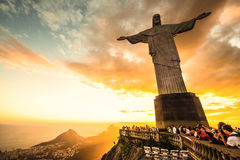 Jesus Christ over Rio de Janeiro. RIO DE JANEIRO, MARCH 3: Tourists are happy to see the first sunset after a week of rain and thunderstorms on the Corcovado Stock Image