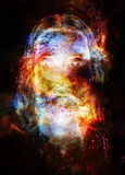 Jesus Christ painting with radiant colorful energy of light in cosmic space, eye contact. Royalty Free Stock Photo