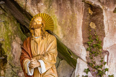 Jesus Christ praying. Jesus Christ while praying in the garden of olive trees Royalty Free Stock Image