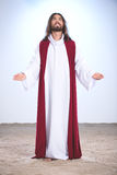 Jesus Christ praying to God. Holding open arms Stock Photography