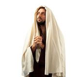 Jesus Christ prays with clasped hands. Turning our gaze to his father Stock Photo