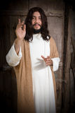 Jesus Christ preaching. Portrait of a model in the role of Jesus Christ praying or preaching Royalty Free Stock Photos