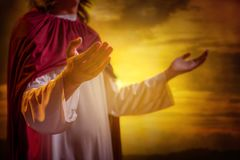 Jesus christ raising hands and praying royalty free stock image