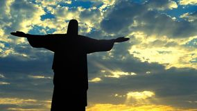Jesus Christ redeemer statue silhouette in Rio de Janeiro Brazil against celestial sky timelapse.  stock footage