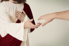 Jesus Christ. Jesus saving hand reaching for the faithful Royalty Free Stock Image
