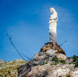 Jesus Christ sculpture on a rock in Mijas. Royalty Free Stock Photos
