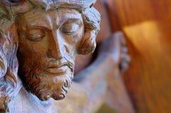 Jesus Christ sculpture. Wooden sculpture portrait of Jesus Christ on crucifix stock image
