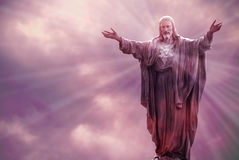 Jesus Christ statue against beautiful sky background. Jesus Christ in Heaven with rays of light religion concept Royalty Free Stock Photo