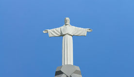 Jesus Christ. Statue in the background of the cloudless sky Royalty Free Stock Photos