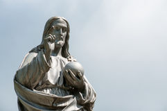 Jesus Christ statue on blue. Heaven background stock photo