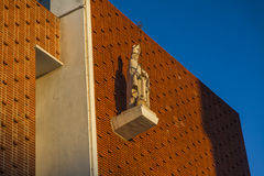 Jesus Christ statue in the front wall of a church. Easter Royalty Free Stock Image