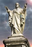 Jesus Christ statue with light flare near of his head. Religious symbol of Christianity Royalty Free Stock Images