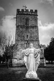 Jesus Christ Statue Outside Old English Church HDR BW. Jesus Christ Statue Outside Old English Church HDR black and white tone Royalty Free Stock Images