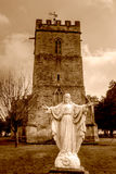 Jesus Christ Statue Outside Old English Church HDR Sepia Stock Images