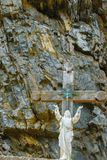 Jesus Christ statue in the rock with hands pointing to the sky Royalty Free Stock Photos