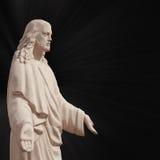 Jesus Christ staty mot svart bakgrund Royaltyfri Bild
