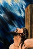 Jesus Christ sull'incrocio contro un cielo scuro Immagini Stock