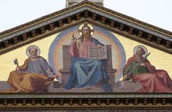 Jesus Christ the Teacher, Saints Peter and Paul. Mosaic of Jesus Christ the Teacher, Saints Peter and Paul, Basilica of Saint Paul oute the walls, Rome, Italy Royalty Free Stock Photography