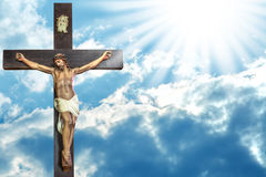 Jesus Christ Cross. Jesus Christ to paradise: cross of Jesus Christ on sky background with a shining celestial light from above Royalty Free Stock Photo