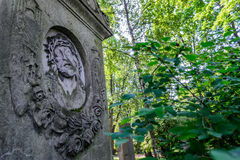 Jesus Christ on the tombstone. The image of Jesus Christ on the old tombstone historic cemetery in St. Petersburg. Decorative bas-relief of Christ on the stone royalty free stock images