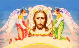 Jesus Christ between two angels. Icon of Jesus Christ painted with beautiful colors Royalty Free Stock Photo