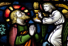 Jesus Christ und der Engel, der die Schale hält Lizenzfreie Stockbilder