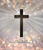 Jesus Christ wooden cross and He is risen text for Easter Stock Images